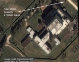 September 11, 2005 satellite photos showing the 5MWe reactor at Yongbyon with a steam plume indicating that it is again operational and the construction site for the 50MWe reactor showing some new activity at the site. Photo