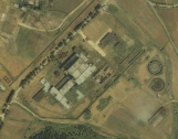 June 10, 2005 satellite images of the 5 MWe Reactor which appears to be not operating and the 50 MWe reactor prior to the reported restart of construction. Photo